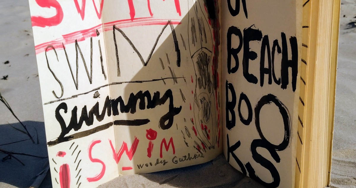 """Inside cover of """"Les Mots"""" by Jean Paul Sartre, painted by Jonny Hannah. Gift to the Sea Library. Photo: Beach Books"""
